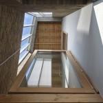 Wintertuin als akoestische en thermische buffer in nieuwe hoekwoning in Ledeberg
